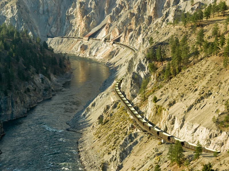 Grizzly Bears & the Canadian Rockies Train Vacation | Train traveling throughFraser Canyon